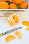 Clementines, peeled and unpeeled