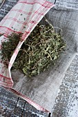 Dried peppermint leaves in a linen bag