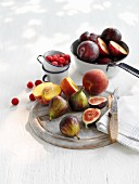Fresh figs, peaches, plums and raspberries