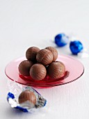 Chocolate truffles on a glass plate
