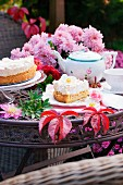 Apple cake, flowers and autumn leaves on a garden table