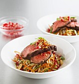 Vegetable salad with beef and pomegranate seeds