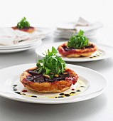 Tartlets with red beets, pine seeds and rocket