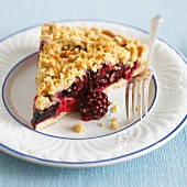 A piece of boysenberry-apple tart with streusel topping