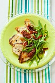 Sliced chicken breast with rocket and dried tomatoes