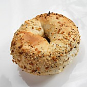 A Single Everything Bagel on a White Background