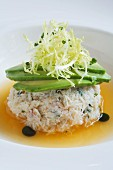 Peeky Toe Crab Salad in a Mango Sauce with Avocado, Shredded Endive and Mint Oil