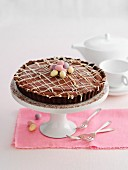 An Easter-themed chocolate cake on a cake stand