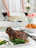 A table laid for a meal, with a roast leg of lamb