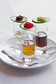 Trio of shots with assorted caviar top