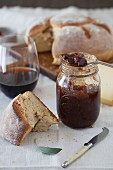 A Jar of Plum Jam with Bread and Wine