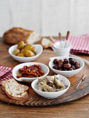 Assorted antipasti and white bread