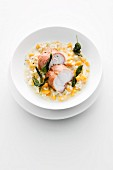 Monkfish wrapped in Parma ham on squash risotto