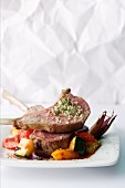 Mediterranean lamb chops with herb salt on ratatouille