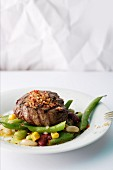 Beef steak with chilli salt and colourful beans