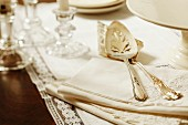 Antique cake serving knives on linen napkins