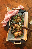 Oven-roasted quails with mushrooms and vegetables