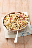 Herring salad with salami, sausages, eggs and pickled gherkins