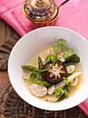 Clear shiitake mushroom soup with green asparagus