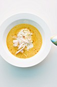 Carrot soup with coconut shavings