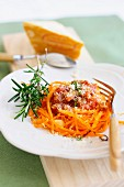 Carrot nest with tomatoes and parmesan