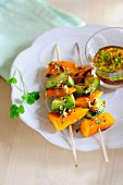 Barbecued skewers of squash and avocado