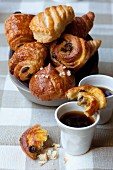 Sweet Danish pastries and cups of coffee