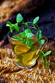 A glass of peppermint tea with lime slices