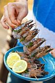 Raw prawn skewers with herbs and lemon