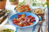 A salad of grilled peppers, prawn skewers and kiopoolu paste