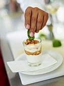 Apple and cinnamon compote with mascarpone cream, a walnut and a mint leaf