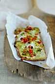 Flatbread topped with broccoli, chilli and onions