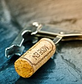 A wine cork on a corkscrew