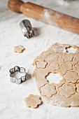 Shapes being cut out of biscuit dough