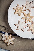 Decorated Christmas biscuits in the shape of snowflakes