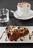 A slice of almond cake and cappuccino
