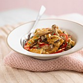 Pieces of chicken with mushrooms and peppers