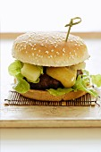Asian burger with pineapple and curry sauce