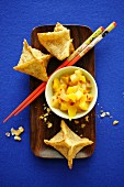 Won tons with prawns filling and mango salad