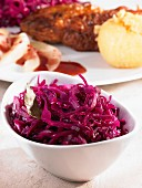 Red cabbage in a bowl as an accompaniment