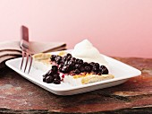 Pancake with blueberries and cream