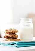 A Stack of Homemade Chocolate Chip Cookies with Milk in a Mason Jar