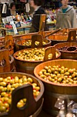 Barrels of Olives in a Market
