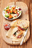 Panini with Camembert and a salad with apple and deep-fried Camembert