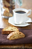 Almond biscotti biscuits served with a cup of black coffee