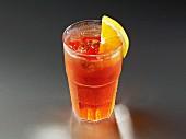 A glass of iced tea with lemon