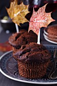 Chocolate muffins with toppers made from painted autumn leaves