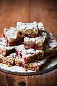 Cherry cake with crumble topping and icing sugar
