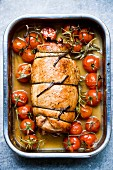 Rolled roast turkey with cherry tomatoes