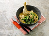 Chicken leg with green asparagus in curry sauce